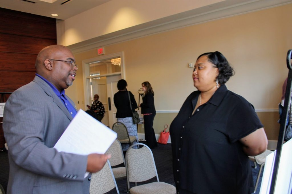 Panelist, Chauncey Spears talks with doctoral student, Alina Harges about her poster presentation on restorative justice.