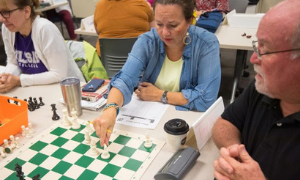 Making Moves to Enhance Academics: Teachers Attend UM Chess Workshop