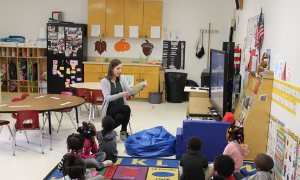 Teacher reading to students at Water Valley day care center.